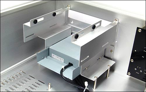 HD160 optical drive bay showing one of the four vibration-damped HDD mountings above it