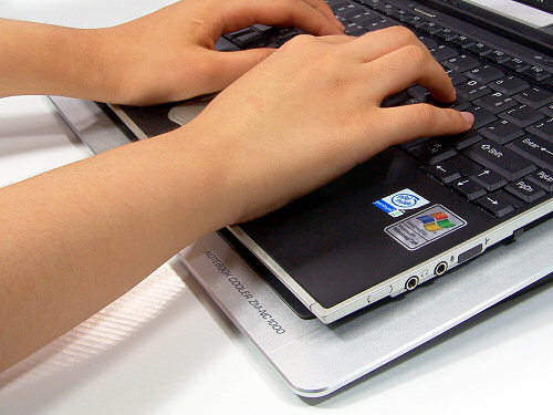 The laptop keyboard is raised for improved ergonomics